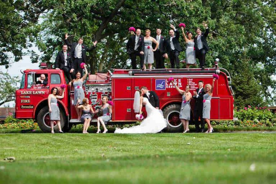 Wedding party posing by fire truck at Lake Lawn Resort