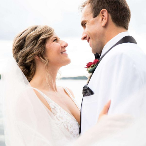 Bride smiles up at groom