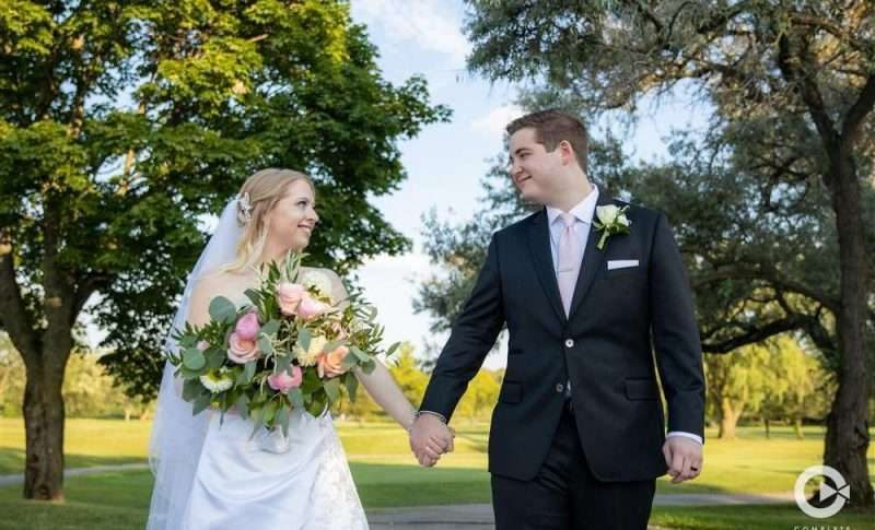 Wedding Couple Walking while holding hands with video by Complete Weddings + Events